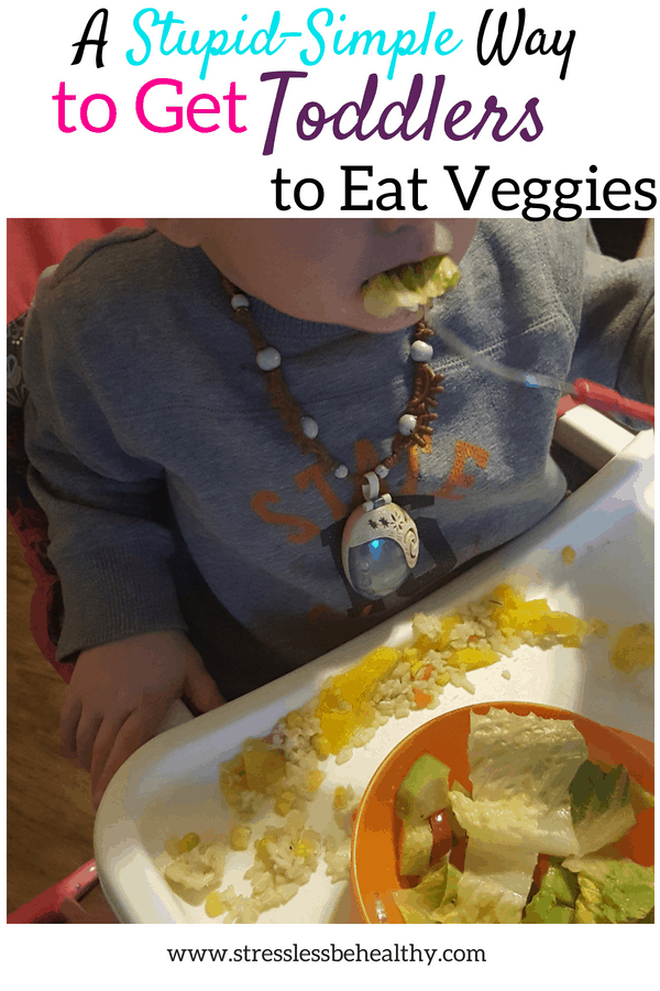 get toddlers to eat veggies, toddler in highchair eating a salad, rice, and mango