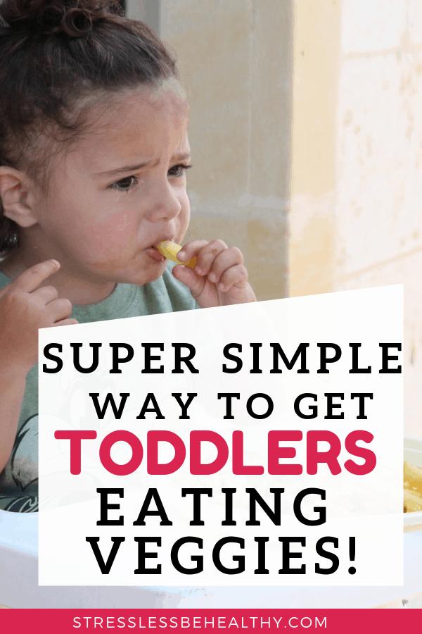 toddler girl eating veggies