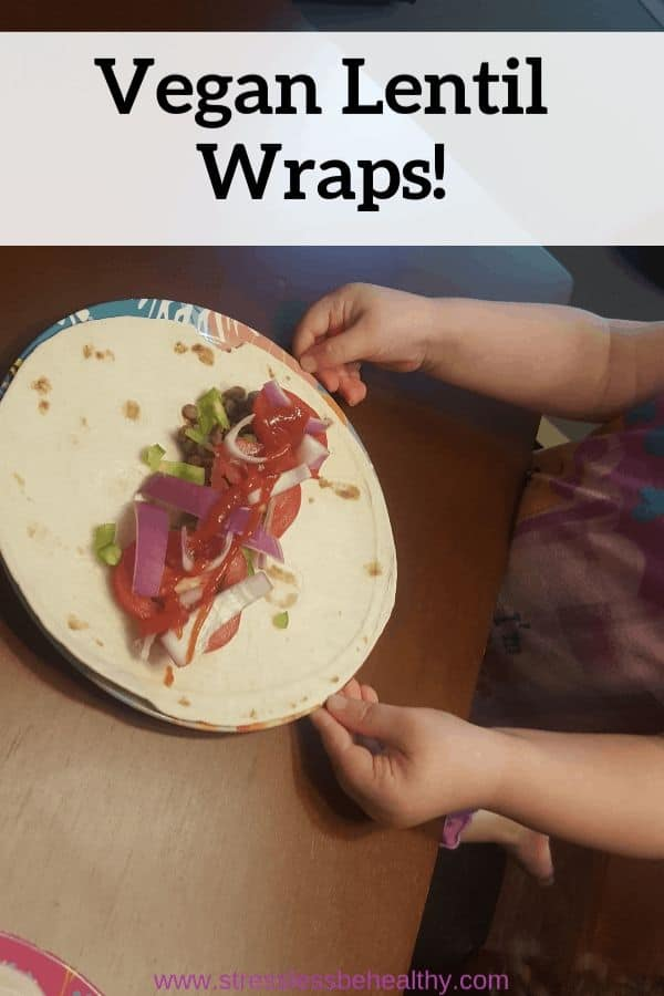 Looking for a healthy vegan wrap recipe that your kids will eat for dinners or lunches You'll want to make this veggie lentil wrap with a side of homemade fries! Absolutely a child, and mother, apporoved meal. #lentils #veganrecipes #veganrecipeswithpotatoes #healthyrecipes #stresslessbehealthy