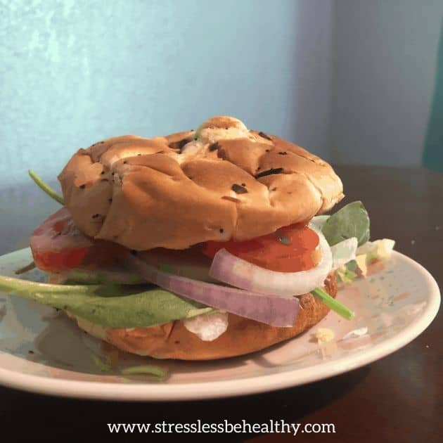 dressing tomato red onion cucumber spinach lettuce on toasted buns