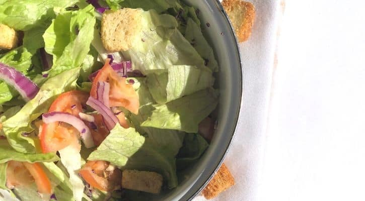 salad. simple salad, salad with croutons, lettuce, tomatoes, red onion