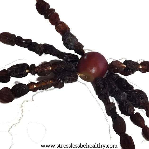 fruit spider from grape and raisins, fun halloween kid craft recipe snack