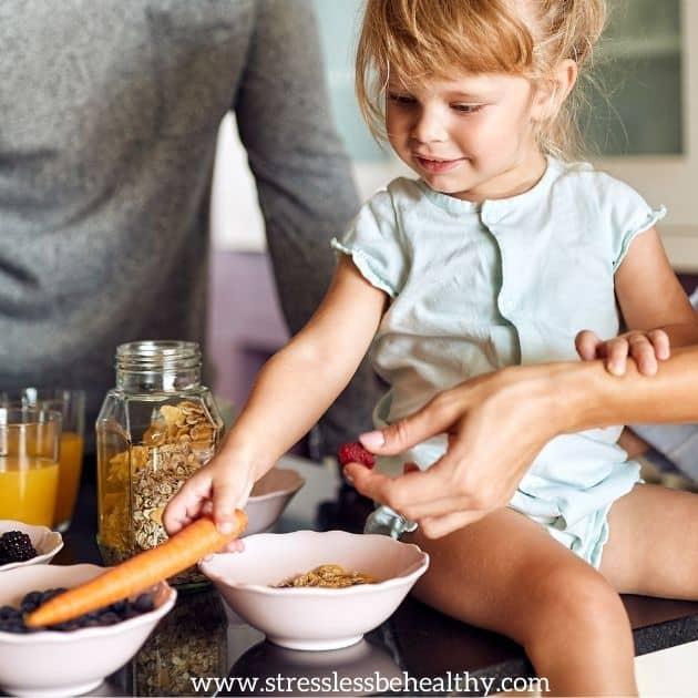 little girl helping make healthy food