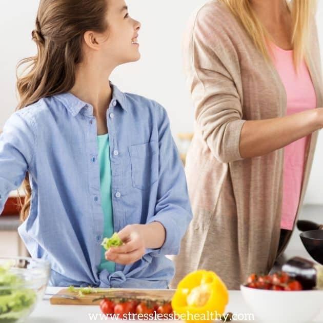 girl helping mom make healthy food